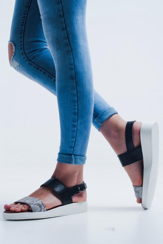Sandalias color negro planas con tira trasera