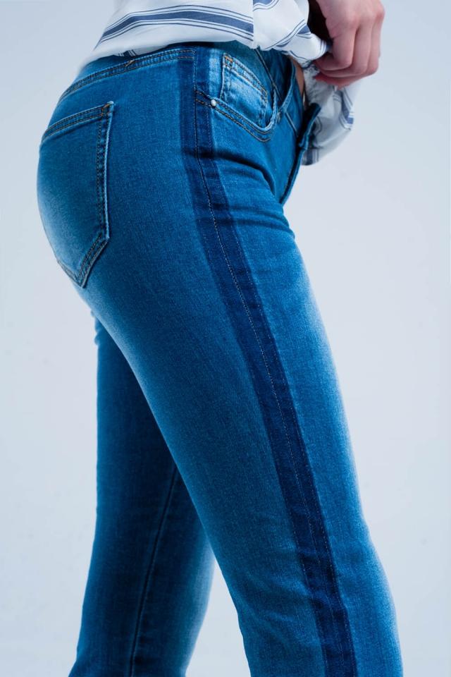 Denim jeans with blue side stripe