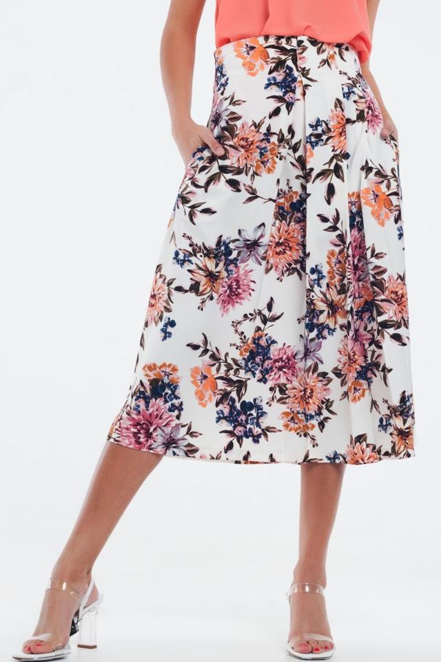 Falda midi plisada con estampado floral en crema