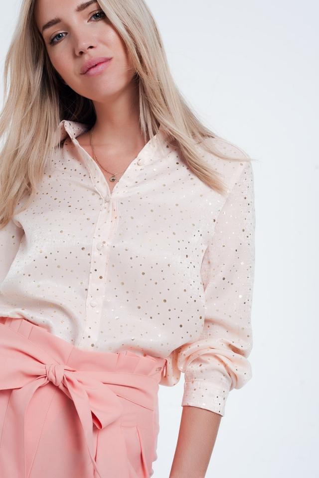 Blusa rosa de manga larga con diseño de lunares dorados