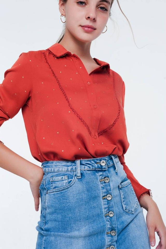 Blusa naranja de manga larga con detalle de cuello