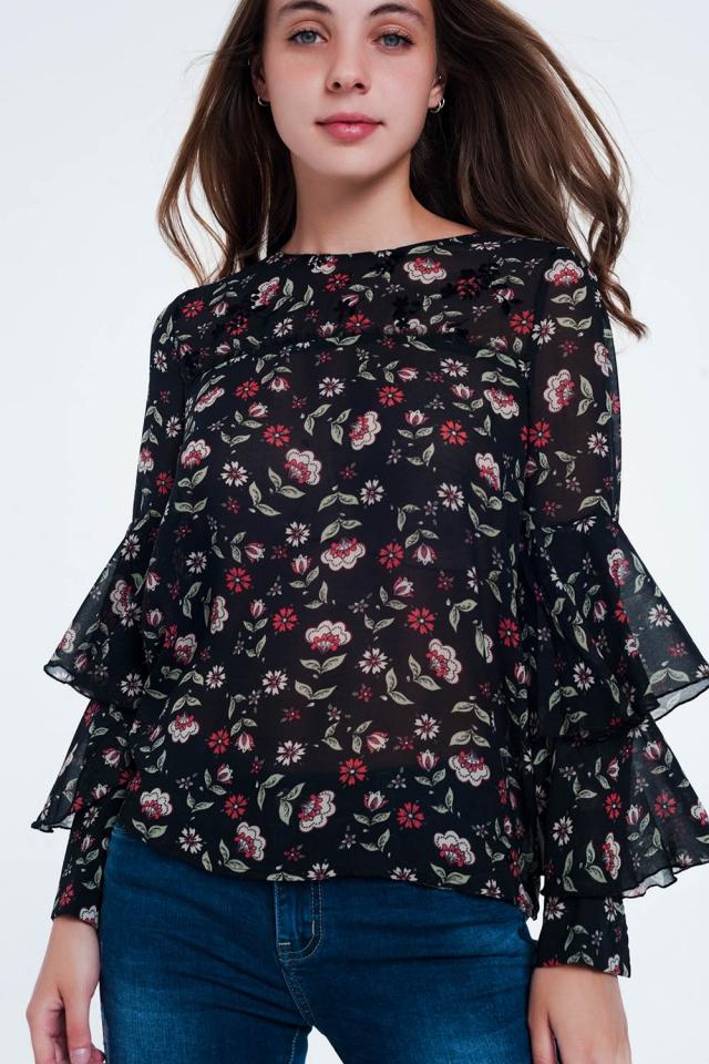 Blusa negra de manga larga con volantes a capas y estampado floral