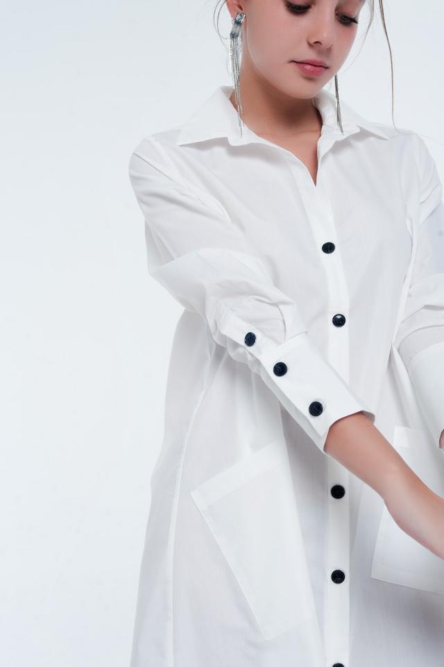 Vestido blanco camisero midi con diseño utilitario con bolsillos