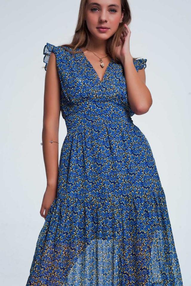 Vestido largo azul con estampado floral y volantes a capas