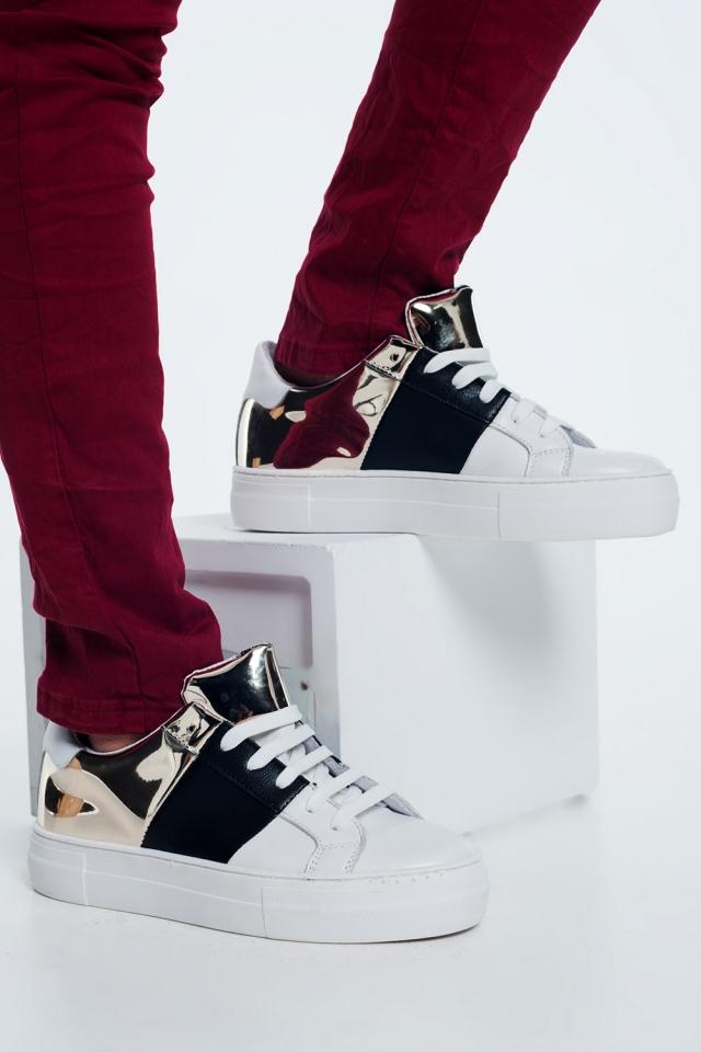 Chunky sneakers en negro y dorado