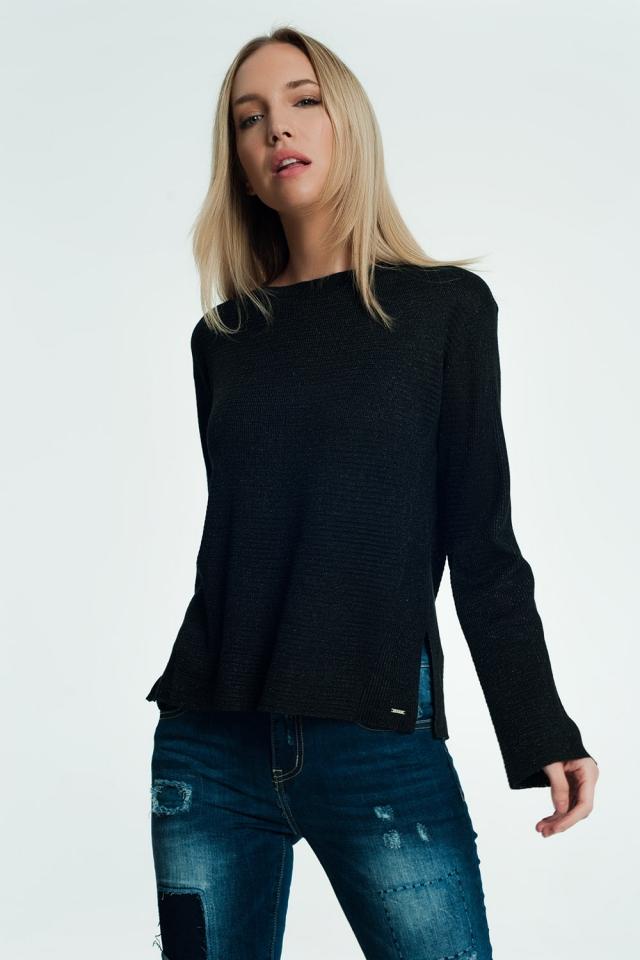 Jersey negro con detalle de aberturas de canalé