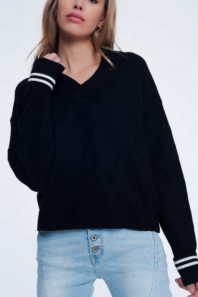 Jersey texturizado con cuello V de color negro