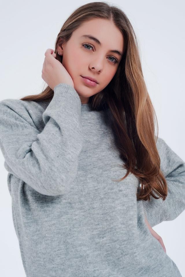 Jersey con cuello redondo y bajo de canalé en gris