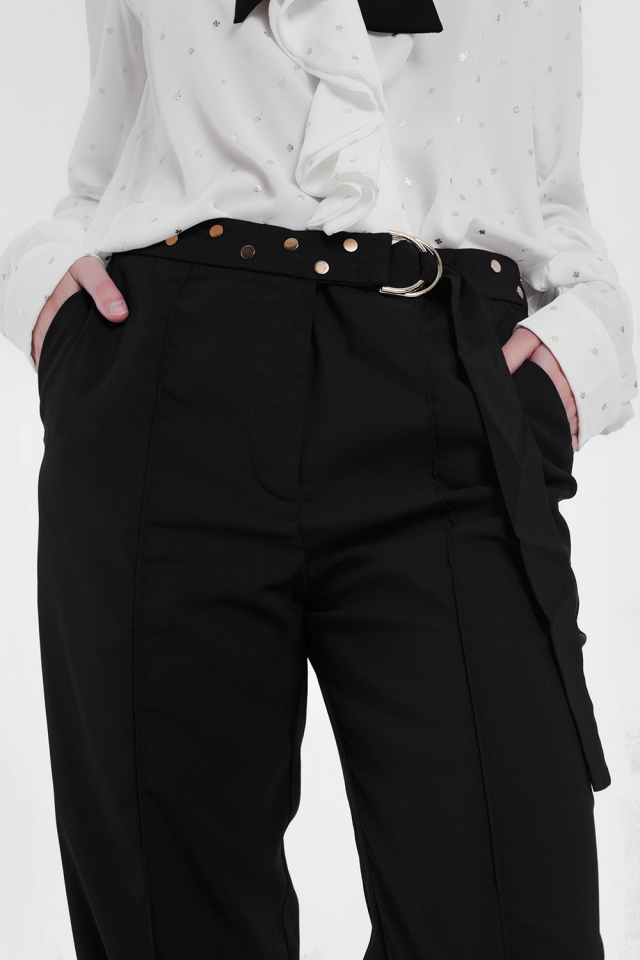 Pantalones con cinturón en negro