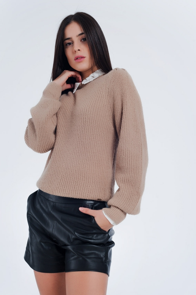 Jersey de canalé beige con manga voluminosa
