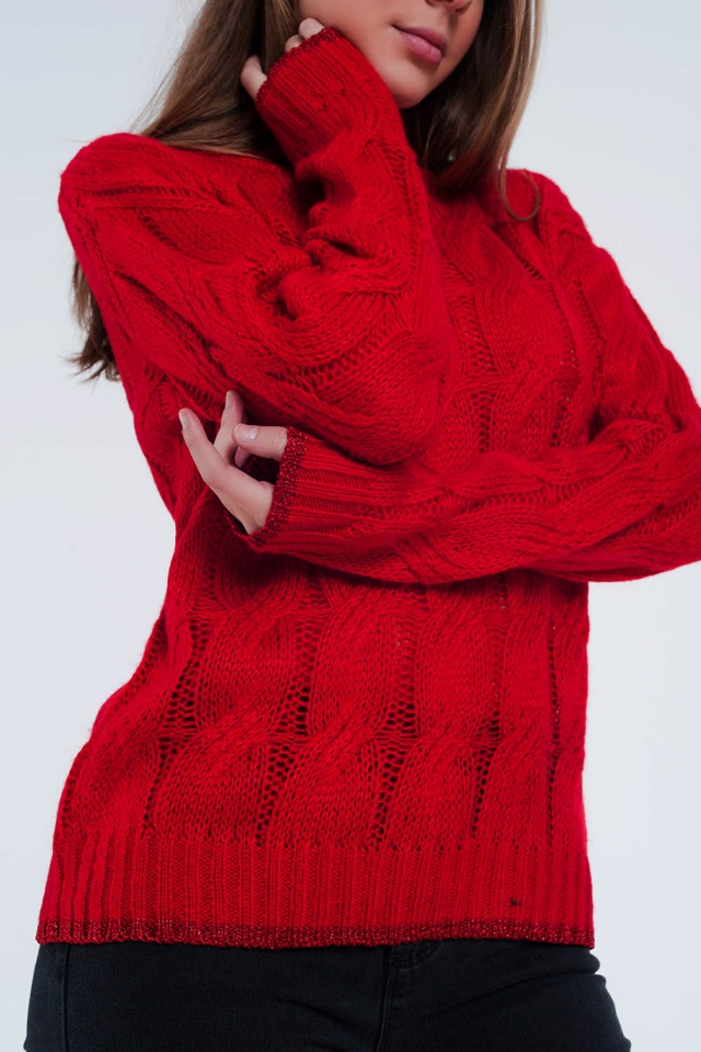 Red sweater with cable knit detail