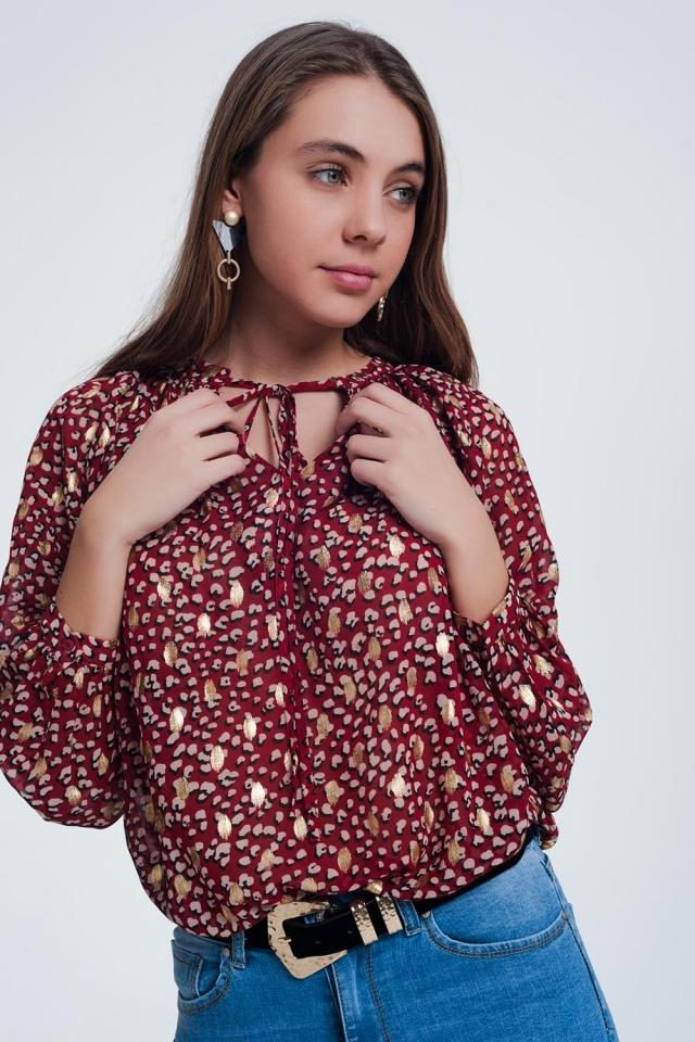 Blusa con lazo en rojo con lunares en relieve dorados