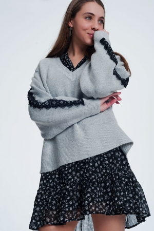 Jersey con aplicaciones de encaje en gris