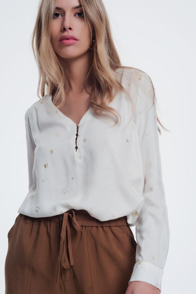 Camisa de manga larga con estampado de estrellas en color crema