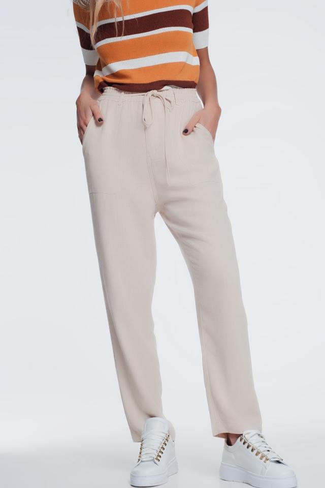 Pantalon largo beige con cintura elástica