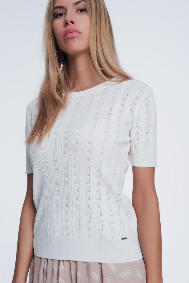 Jersey de canalé de punto fino con manga corta y cuello redondo color crema