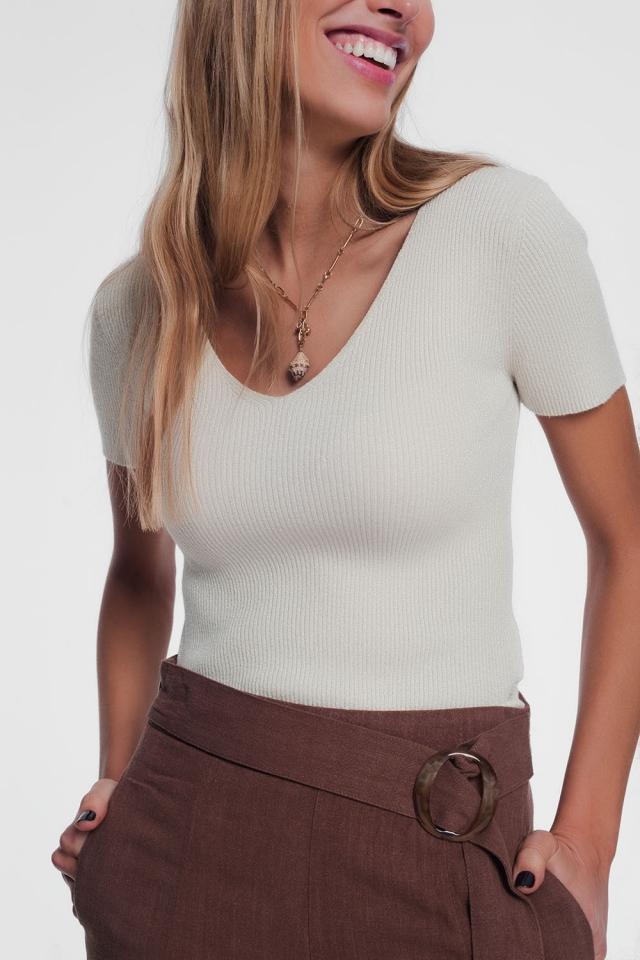 Jersey de manga corta en punto de canalé fino con v ancho crema