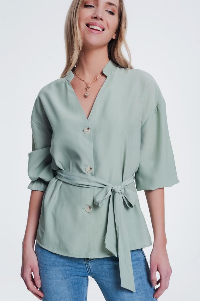 Blusa con botones en la parte delantera y manga abombada color caqui