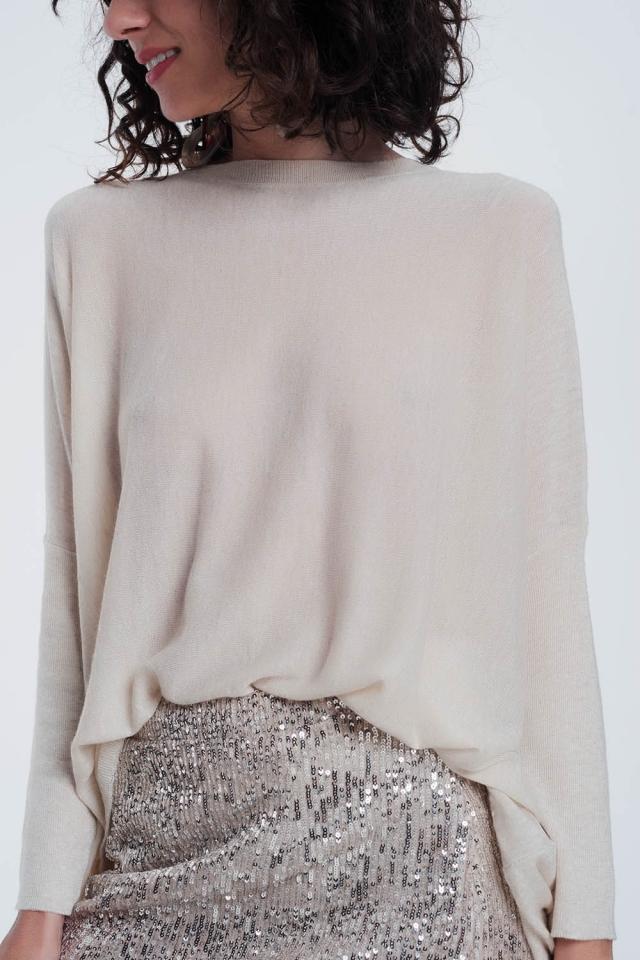 Jersey beige con cuello redondo y manga larga
