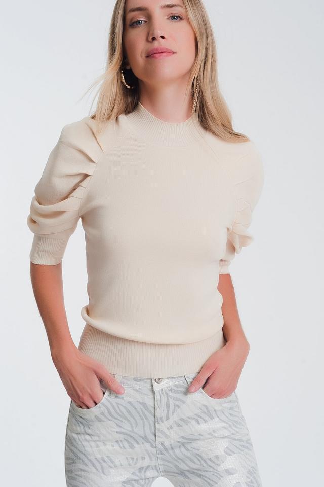 Jersey de punto beige con mangas abullonadas