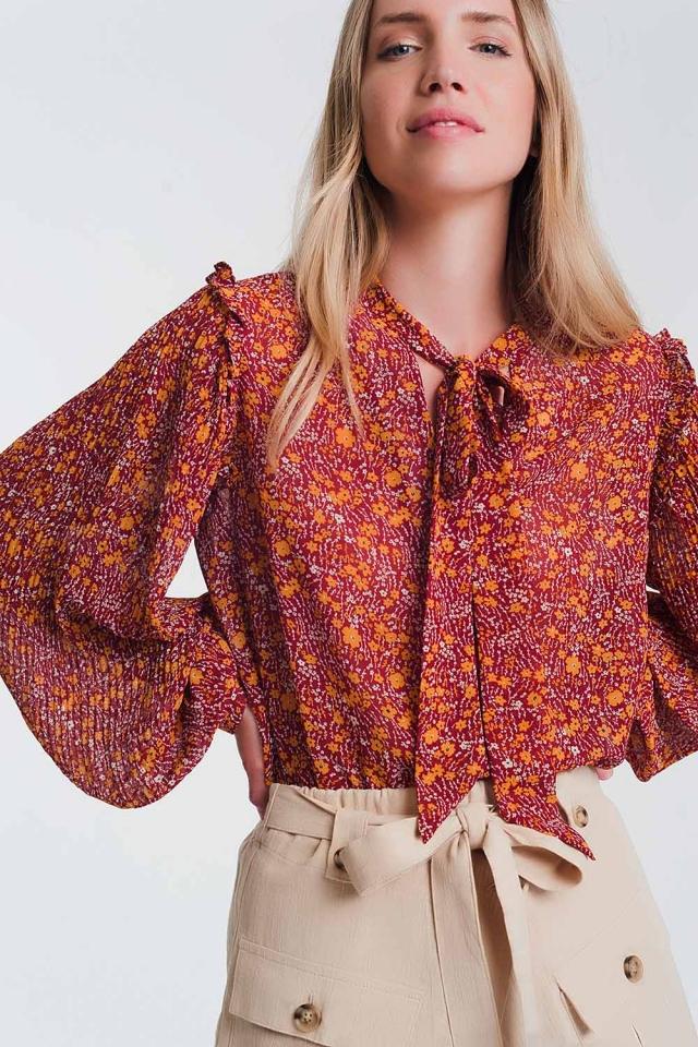 Blusa amplia de gasa con detalle de volante y estampado floral