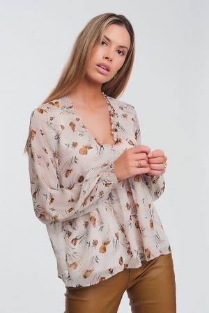 Blusa amplia en beige de manga larga con detalle de volantes en el cuello