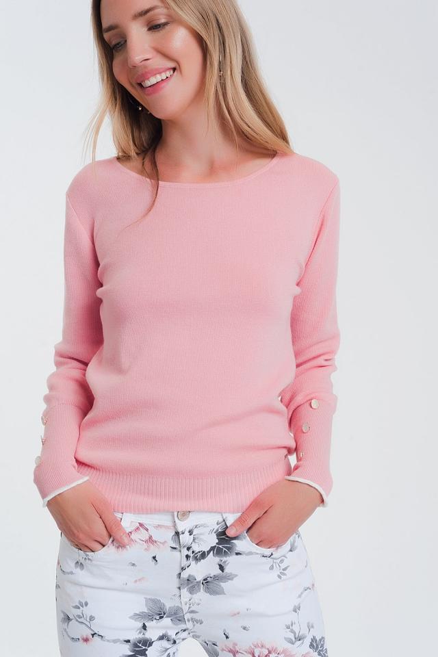 Sueter rosa con botones en la manga y cuello barca