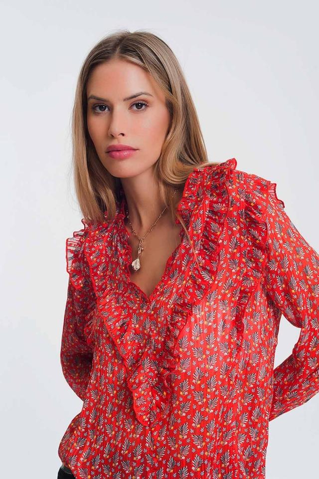 Blusa roja con cuello en V y volantes con estampado