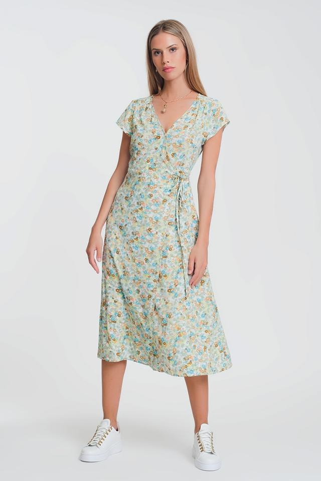 Vestido midi con diseño cruzado y estampado de florecitas en color verde