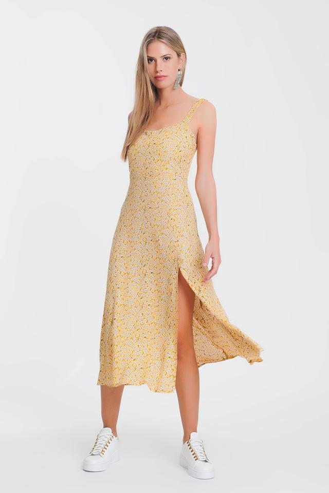 Vestido midi con volantes amarillos con flores