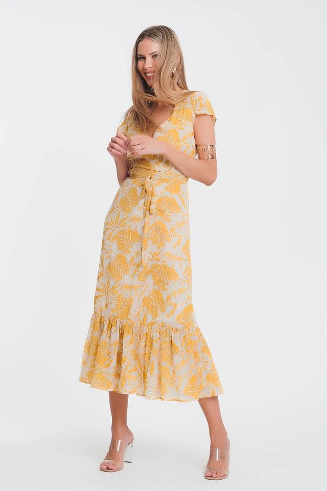 Vestido cruzado y escotado en la parte delantera con estampado tropical de palmeras en amarillo