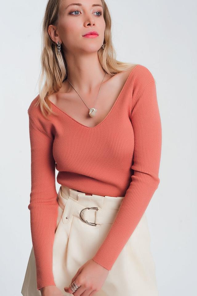 Jersey de punto con escote de pico en la espalda rosa