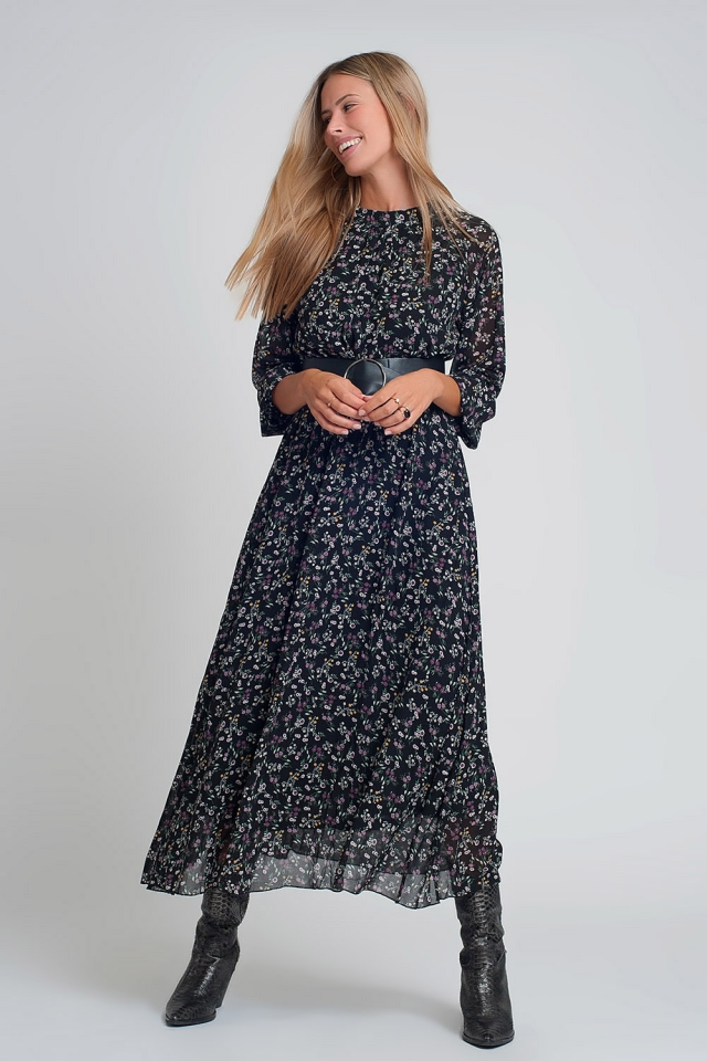 Vestido largo de gasa con mangas abombadas cinturón y estampado de floral en negro