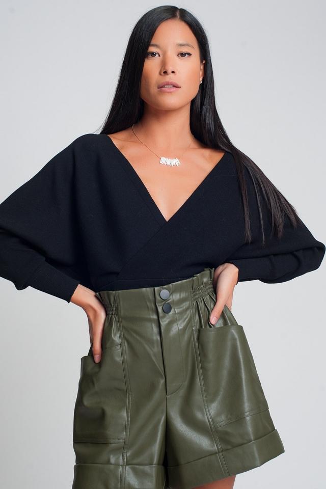 Jersey de punto con cuello de pico envuelto en negro