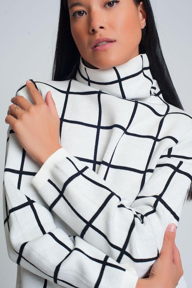 Jersey de punto suave con estampado de cuadros y cuello vuelto en blanco