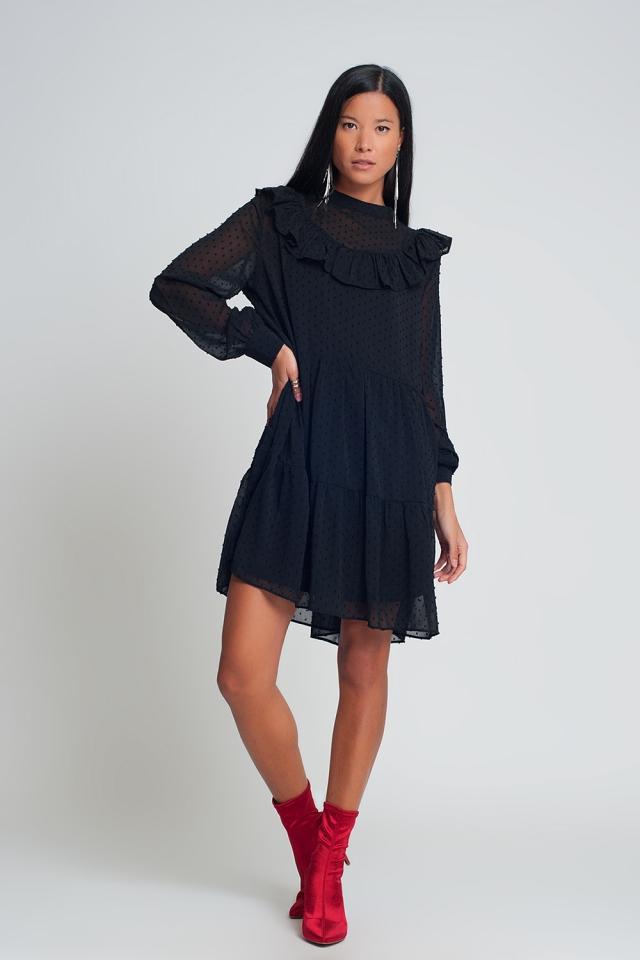 Vestido corto de gasa y amplio con mangas abullonadas,volante y estampado de lunares en negro