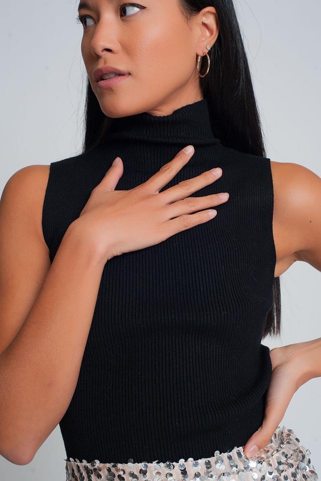 Jersey de canalé sin mangas con cuello alto en negro