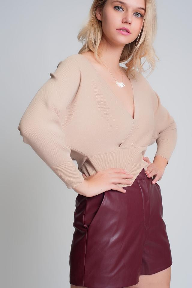 Jersey de punto con cuello de pico envuelto en beige