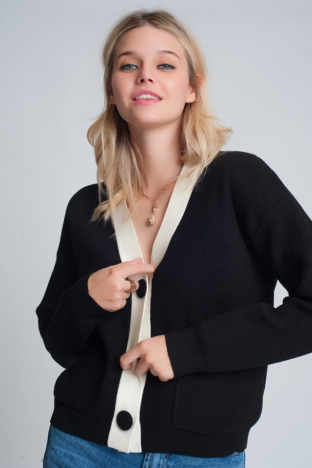 Knitted cardigan with white details in black