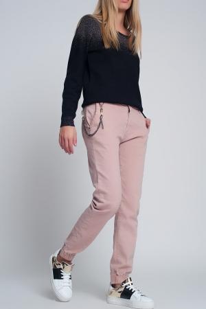 Pantalón utilitario con puños y cadena en rosa