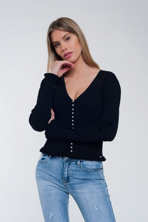 Jersey de canalé en color negro con detalle de botones de perlas