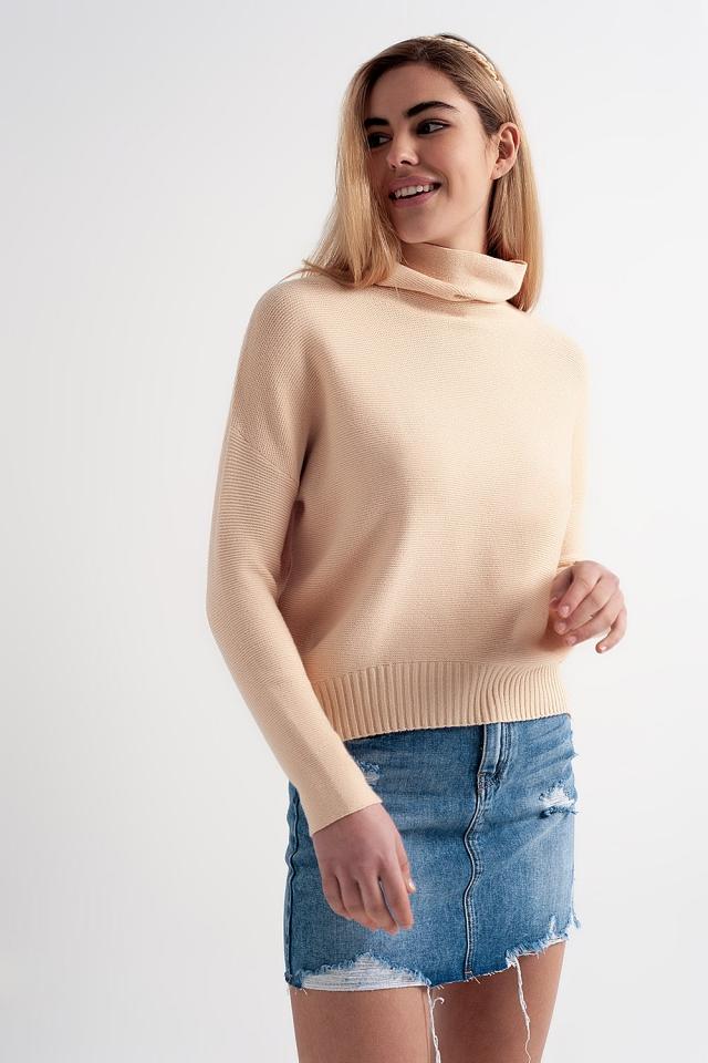 Jersey beige extragrande con cuello desbocado
