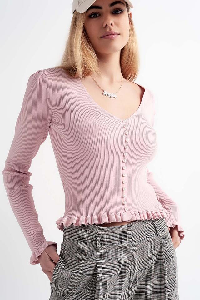 Jersey de canalé en color rosa con detalle de botones de perlas
