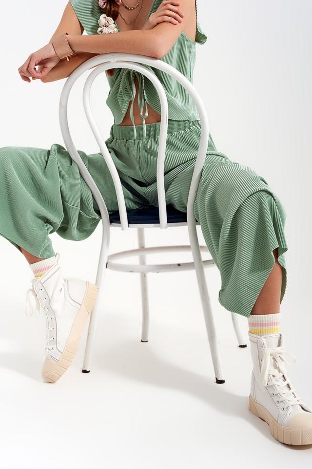 Pantalones plisados estilo culottes en color turquesa