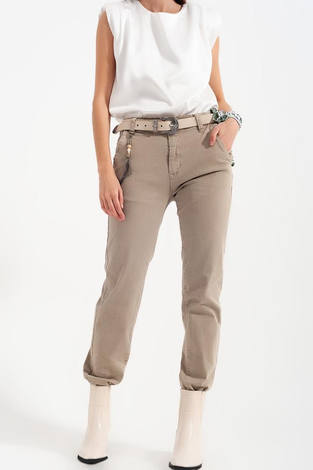 Pantalón utilitario con puños y cadena en beige