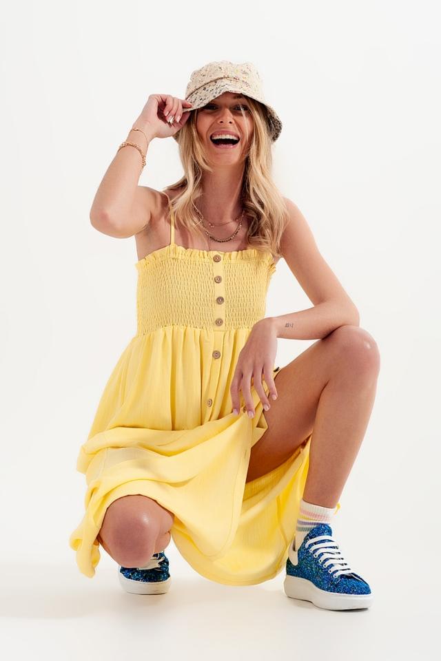 Vestido largo en amarillo con pecho fruncido y bolsillos