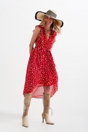 Vestido con bajo asimétrico y parte delantera anudada con estampado de florecitas en rojo
