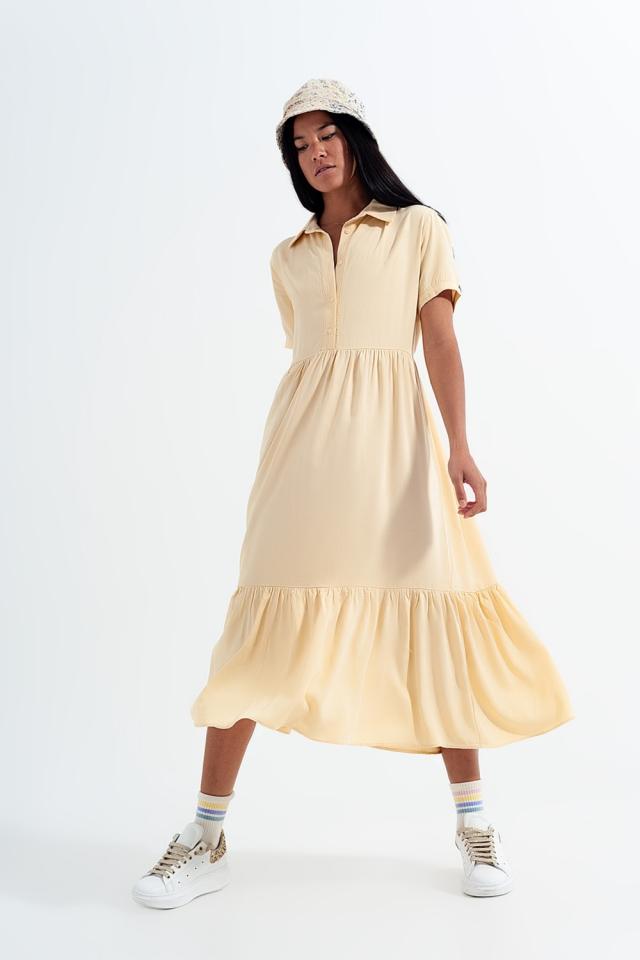Vestido camisero amarillo con bajo escalonado