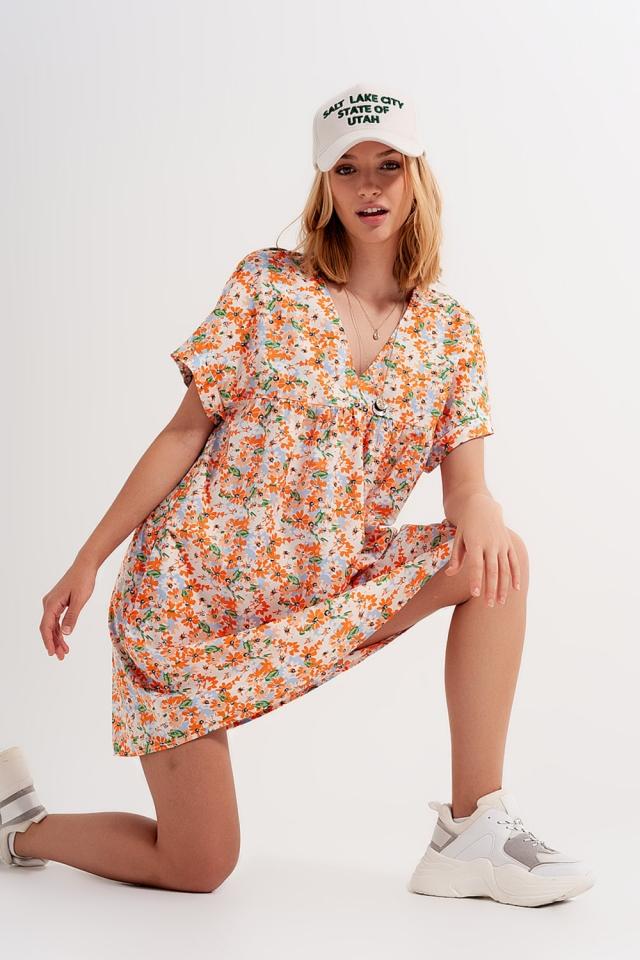 Vestido corto estilo babydoll en algodón con diseño floral en naranja