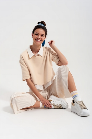 Pantalones plisados estilo culottes en color crema